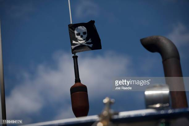 A skull and crossbones flag is seen on a lobster boat docked at the Conary Cove Lobster Co Inc in the Gulf of Maine on July 01 2019 in Deer Isle...