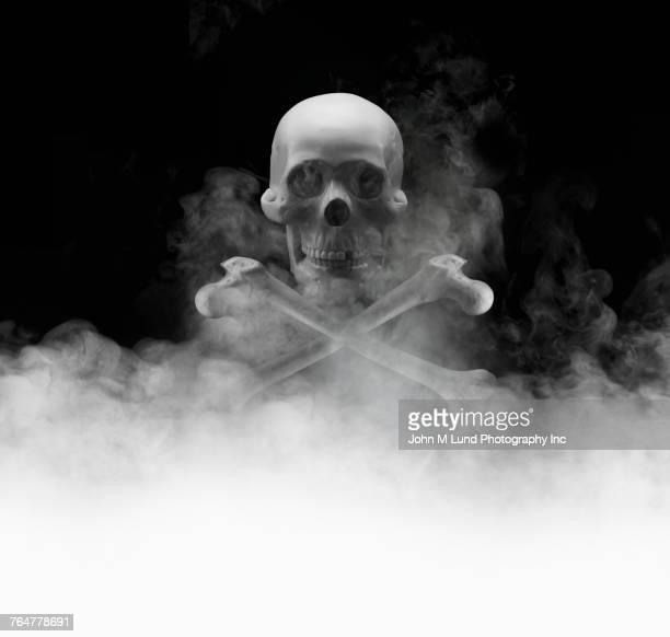 Skull and crossbones in smoke