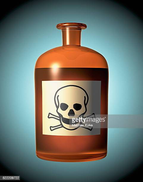 skull and crossbones on a glass bottle - toxin stock pictures, royalty-free photos & images