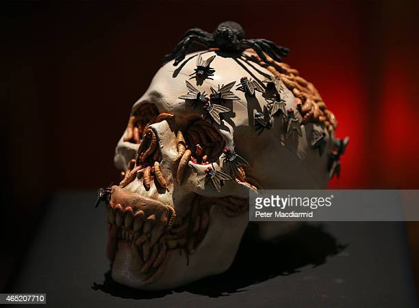 A skull by Jake Dinos Chapman called 'Migraine' is shown at Sotheby's Bear Witness collection on March 4 2015 in London England The collection was...
