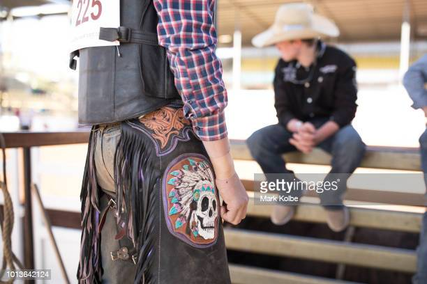 A skull design on the chaps of a competitor is seen as he prepares himself for competition in the junior bull ride during the Rodeo Sound Check of...