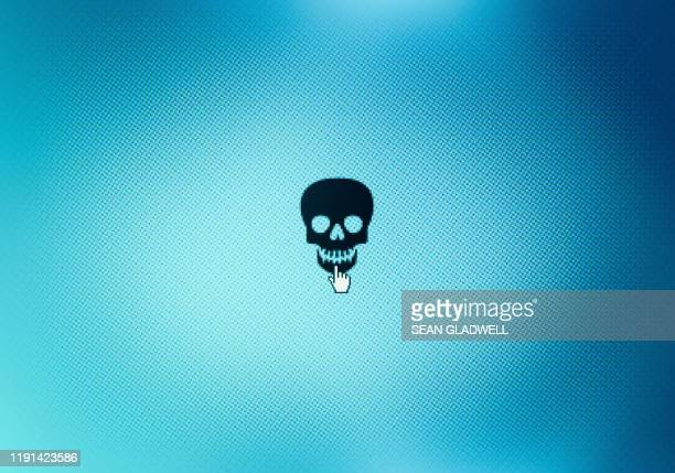 skull icon on monitor screen - computer virus stock pictures, royalty-free photos & images
