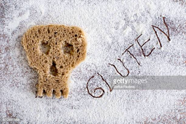 skull made of bread toast and the text GLUTEN