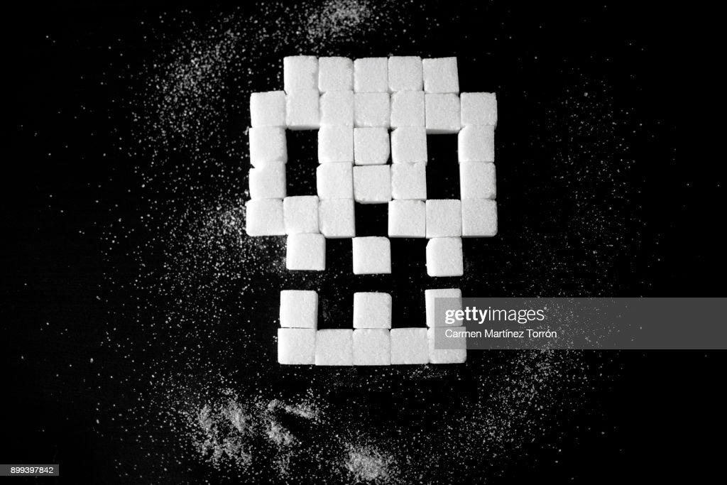 Skull made of sugar cubes, unhealthy food. : Stock Photo