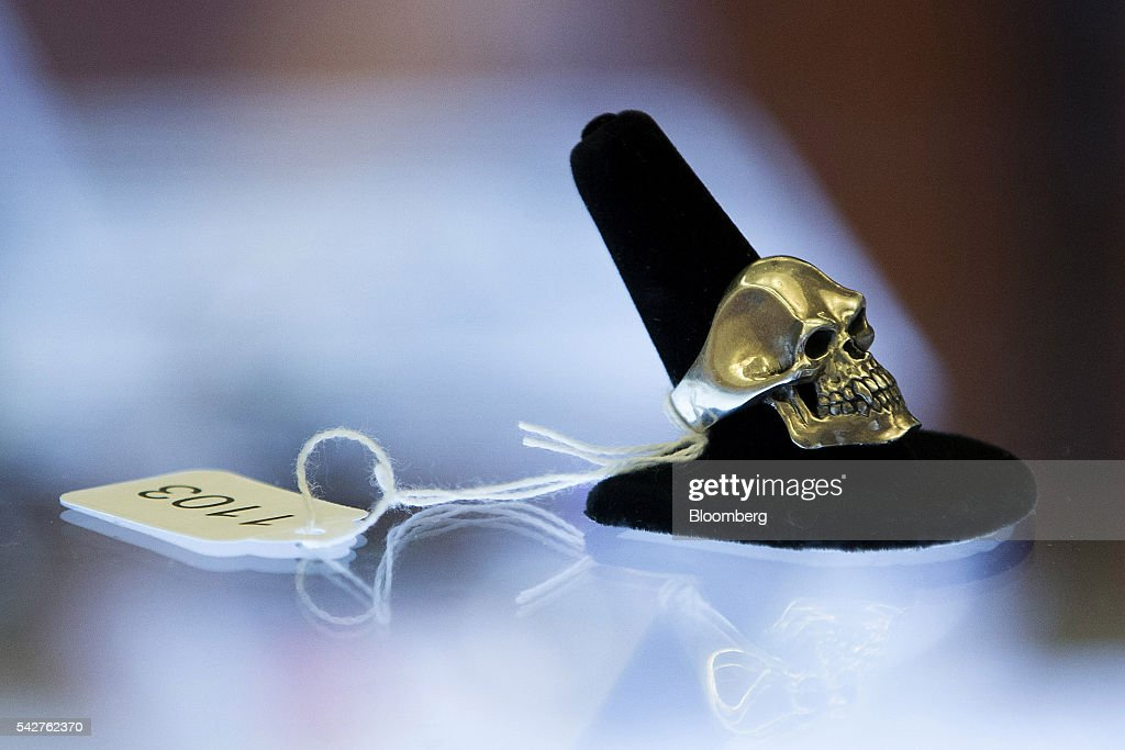A skull ring belonging to notorious Boston mobster James 'Whitey' Bulger is displayed during a press preview before an asset-forfeiture auction in Boston, Massachusetts, U.S., on Friday, June 24, 2016. The U.S. Marshals Service auctioned off items seized in 2011 from the Santa Monica hideout of the Bulger and his girlfriend, Catherine Greig. Photographer: Scott Eisen/Bloomberg via Getty Images