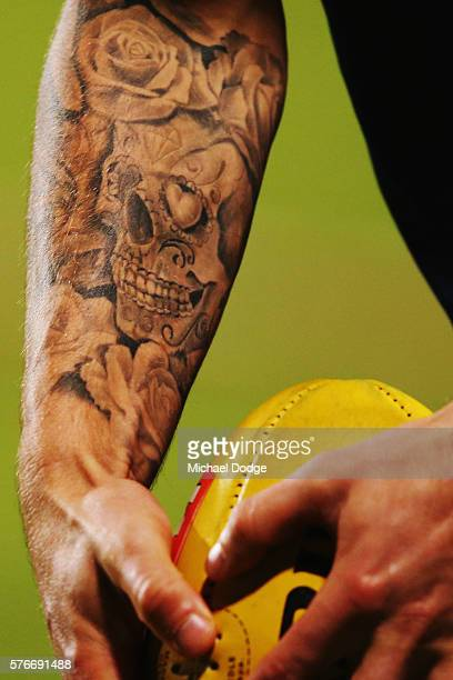A skull tattoo is seen on the arm of Clay Smith of the Bulldogs during the round 17 AFL match between the Western Bulldogs and the Gold Coast Suns at...