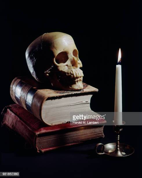 Skull with books and candle