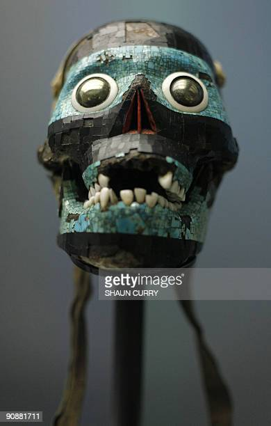 A skull with mosaic dating 1500 also known as 'the blue Tezcatlipoca' is pictured at the 'Moctezuma Aztec Ruler' exhibition at the British museum in...