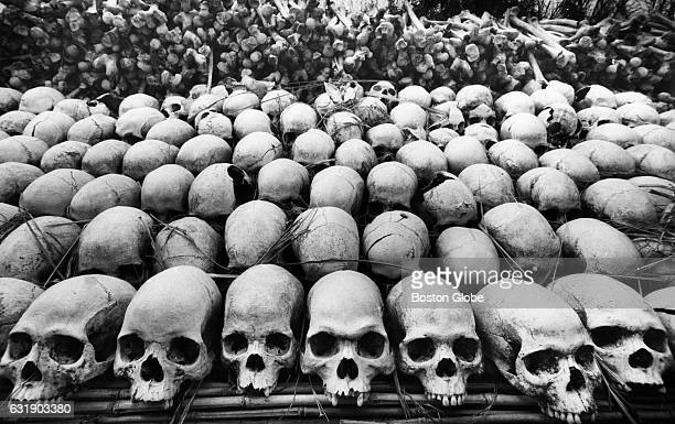 Skulls found by local farmers in the fields of the Luwero Triangle region north of the Ugandan capital of Kampala are displayed as a reminder to the...