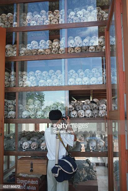 Skulls gathered in a monument to mark the Khmer Rouge genocide at the Killing Fields outside Phnom Penh