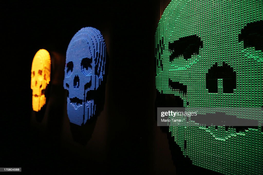 'Skulls,' Nathan Sawaya sculptures, are displayed in the 'Art of the Brick' show at Discovery Times Square on June 18, 2013 in New York City. Sawaya created the pieces entirely with LEGO toy bricks and the exhibition features over 100 works of art created from millions of the toy bricks.