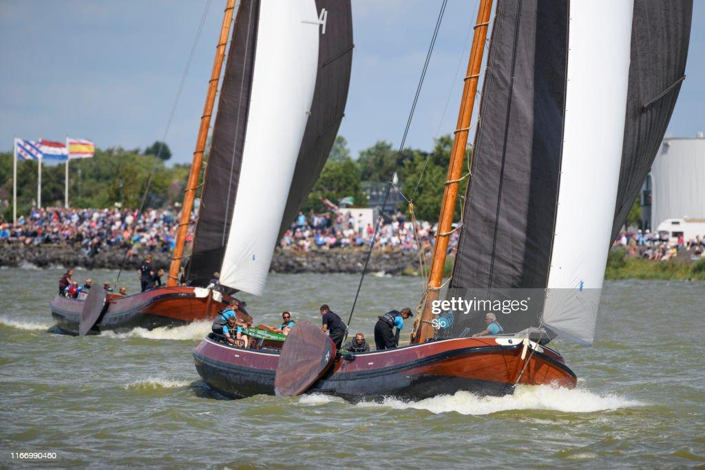 Skutsje classic sailboats sailing on the IJsselmeer near Lemmer in Frisia during the Skutsjesilen : Stock Photo