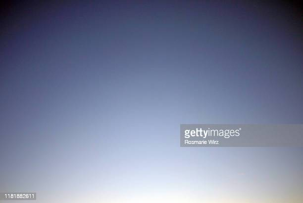 sky above: color gradient from light to dark blue - paradise stock pictures, royalty-free photos & images