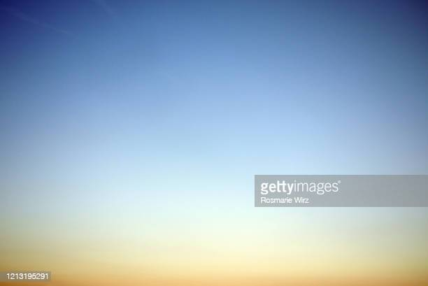 sky above: pastel color gradient from yellow orange to blue - dawn stock pictures, royalty-free photos & images
