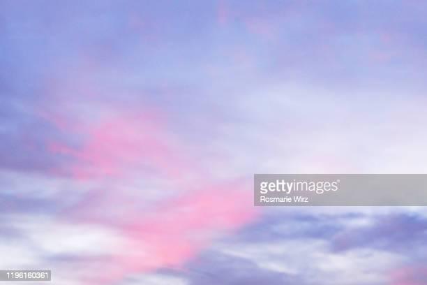sky above: pastel colored cloudscape - hellblau stock-fotos und bilder