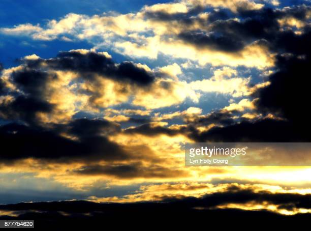 sky and clouds - lyn holly coorg stock photos and pictures