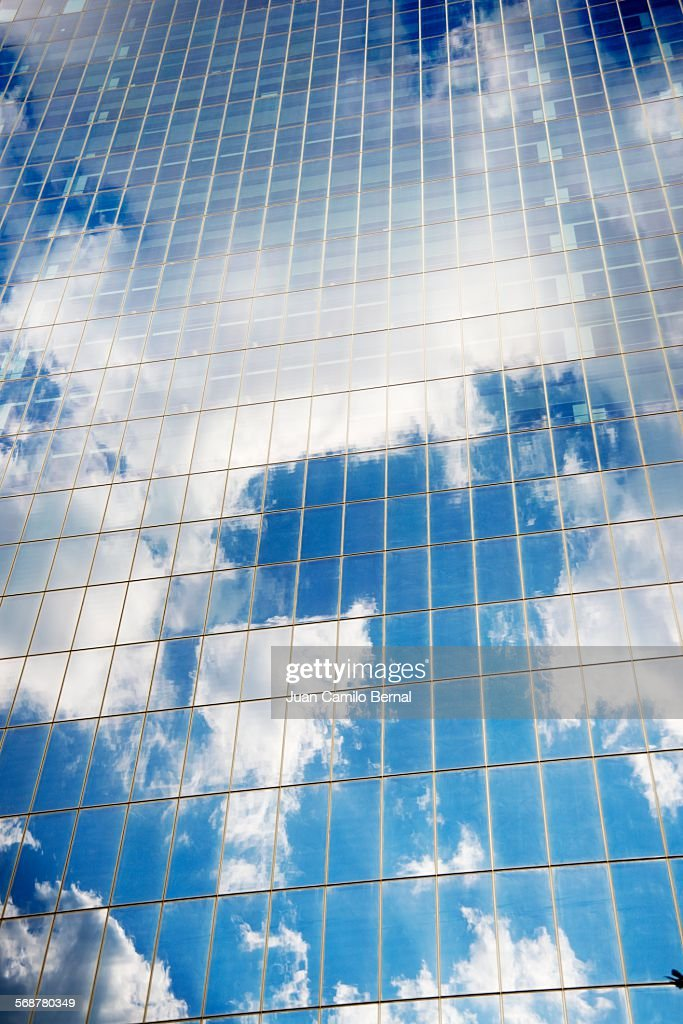 Sky and clouds reflected on building : Stock Photo