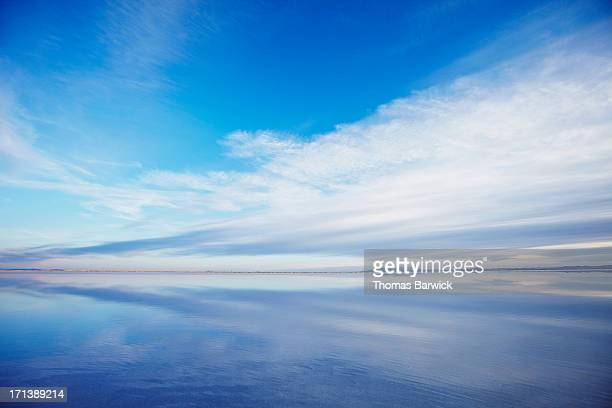 sky and clouds reflecting in calm lake at sunset - horizon over water stock pictures, royalty-free photos & images
