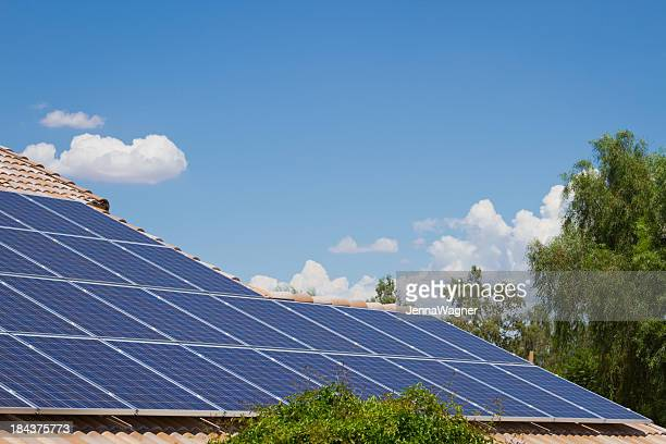 Sky and Solar Panels on Tile Roof