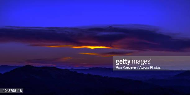 sky at sunset above hills in henry w. coe state park - koeberer stock photos and pictures