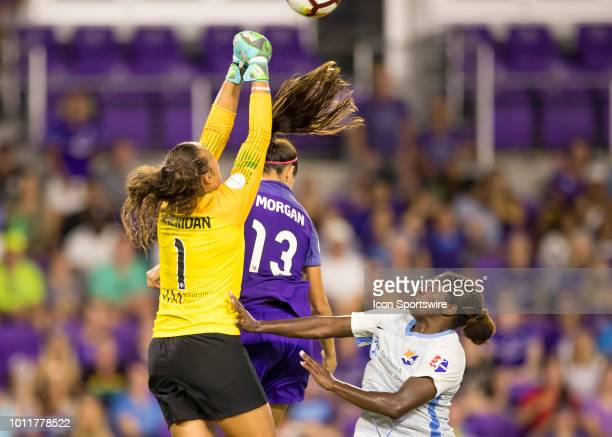 Sky Blue FC goalkeeper Kailen Sheridan punch saves the ball away from Orlando Pride forward Alex Morgan during the NWSL soccer match between the...