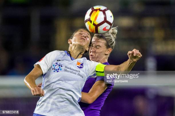 Sky Blue FC midfielder Carli Lloyd and Orlando Pride defender Alanna Kennedy go up for a header during the soccer match between The Orlando Pride and...
