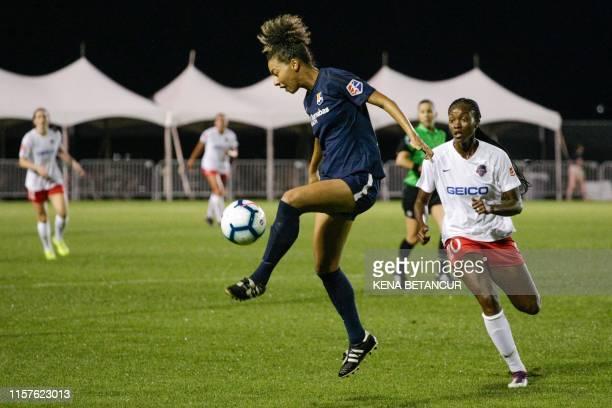 Sky Blue's defender Estelle Johnson kicks the ball past Washington Spirit forward Cheyna Matthews during the National Womens Soccer league match...