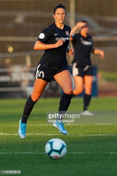 Sky Blue's forward Carli Lloyd looks on the ball during the National Womens Soccer league match between Sky Blue and Washington Spirit on July 24,...
