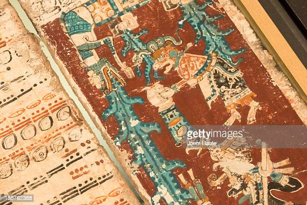 A sky caiman vomits water on one of the last pages of the 12thcentury Dresden Codex also known as the Codex Dresdensis one of four historic Mayan...