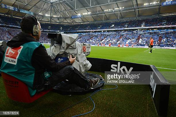 Sky cameraman works at the German first division Bundesliga football match FC Schalke 04 vs FC Bayern Munich on September 22, 2012 in Gelsenkirchen,...