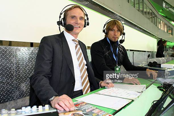 Sky commentator Kai Dittmann and head coach Michael Oenning of 1 FC Nuernberg are pictured prior to the UEFA Champions League Group B match between...