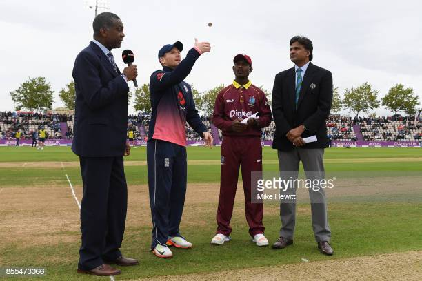 Sky commentator Michael Holding looks on as England captain Eoin Morgan and his West Indies counterpart Jason Mohammed toss the coin during the 5th...