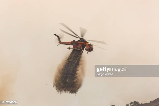 Sky crane doing drops of water on the La Tuna wildfire in Los Angeles