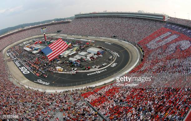 A sky diver brings the American Flag into the track prior to the NASCAR Nextel Cup Series Sharpie 500 on August 26 2006 at Bristol Motor Speedway in...