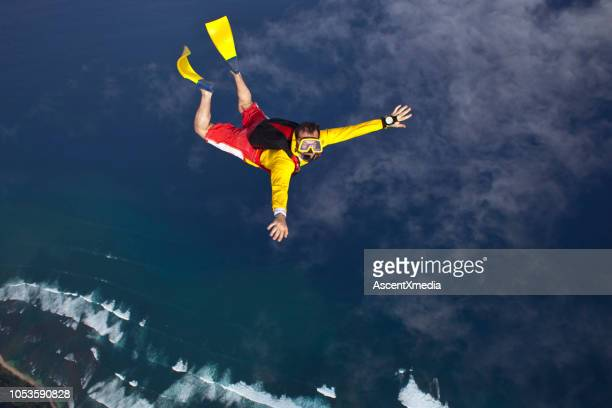 sky diver falls with flippers and a mask - (position) stock pictures, royalty-free photos & images