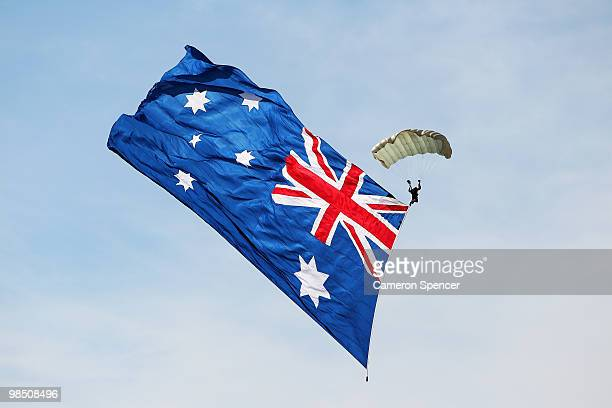 A sky diver flying the Australian Flag enters the course prior to the Red Bull Air Race Qualifying on April 17 2010 in Perth Australia