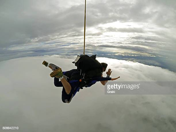 Sky diving tandem cloudy day
