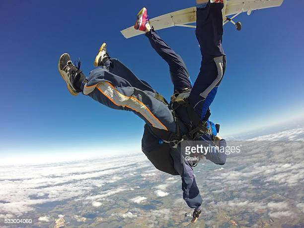 Sky diving tandem exit in head down