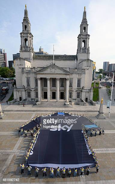 Sky employees unveil the world's biggest cycling jersey in Millennium Square as a show of support for Team Sky as they set off on The Tour de France...