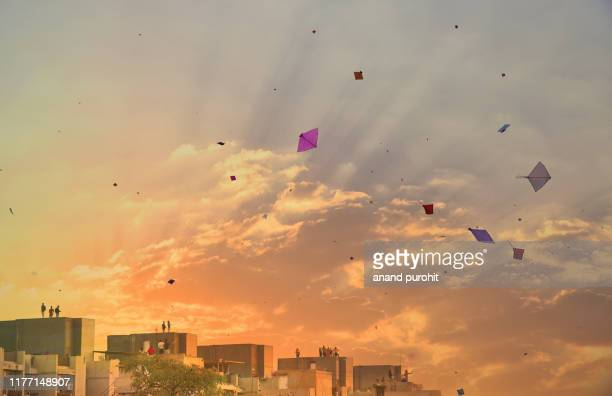 sky full of kites - makar sankranti stock pictures, royalty-free photos & images