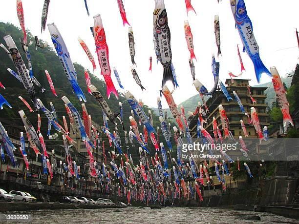 sky full of koi carp streamers - 鯉のぼり ストックフォトと画像