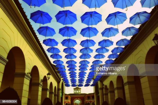 A sky full of umbrellas for a roof