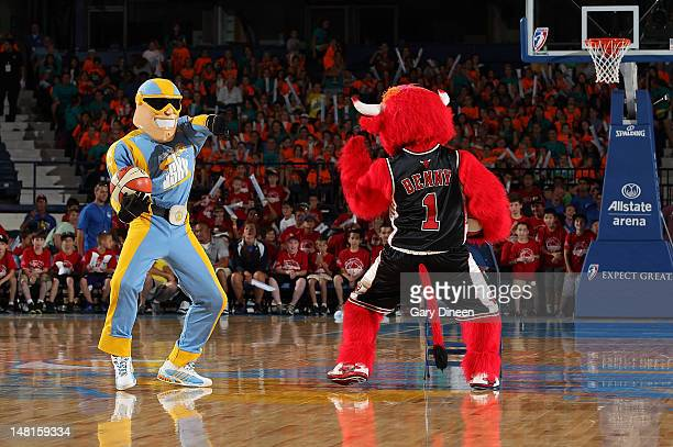 ' Sky Guy' from the Chicago Sky dances with fellow Chicago mascot 'Benny the Bull' during the WNBA game between the San Antonio Silver Stars and the...