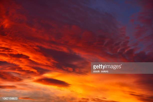 sky in colors of fire - dusk stock pictures, royalty-free photos & images