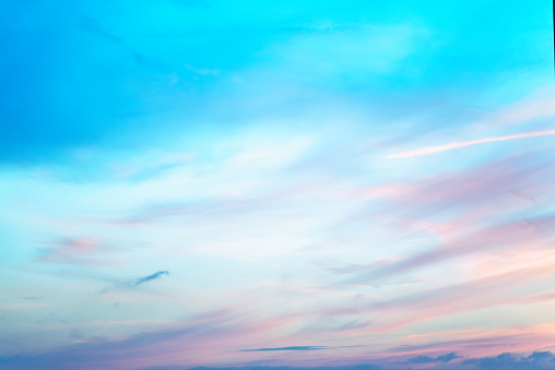 Sky in the pink and blue colors. effect of light pastel colored of sunset clouds cloud on the sunset sky background 1061786950