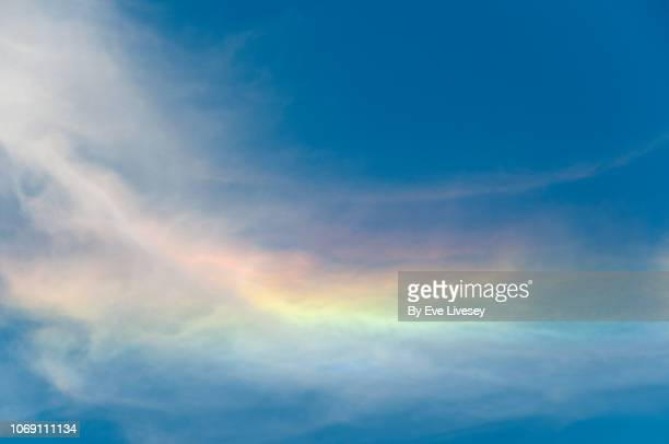sky iridescence - rainbow sky stock pictures, royalty-free photos & images
