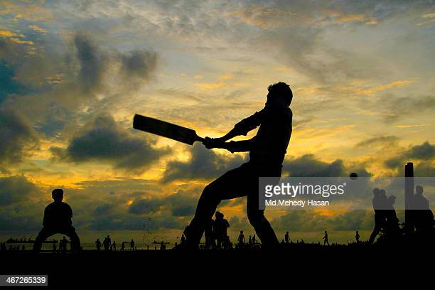 Sky is my play ground where some boys playing cricket that is look like they playing in the sky !