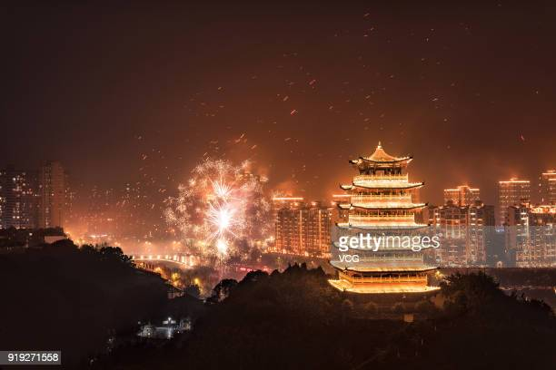 Sky lanterns fly in the air to welcome Lunar New Year on February 15 2018 in Chongqing China The year of the dog is celebrated from the first day of...