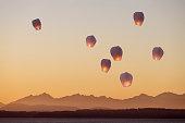 Sky lanterns flying upwards