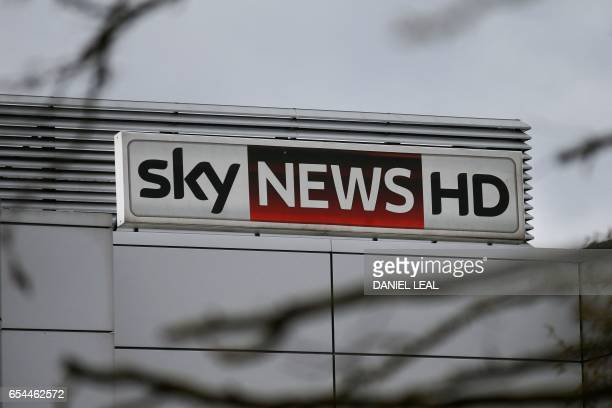 A Sky News HD logo is pictured on a sign outside payTV giant Sky Plc's headquarters in Isleworth west London on March 17 2017 A proposed multibillion...